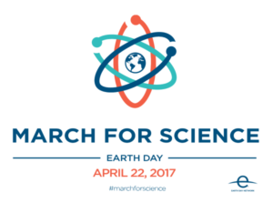 Image Description: A March for Science logo featuring Earth at the center of an atom that has three orbits colored teal, orange and blue from left to right